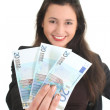 Happy businesswoman showing money — Stock Photo #11840179