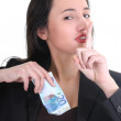 Royalty-Free Stock Photo: Businesswoman hiding money and doing shh sign