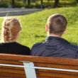 Foto Stock: Man and woman sitting in park