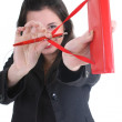 Businesswoman with notepad aiming at you — Stock Photo