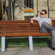 Man sitting in park on the bench — Stock Photo