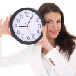 Smiling brunette woman showing clock — Stock Photo
