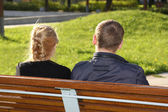 Man and woman sitting in park — Stock Photo