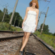 Young woman on the railway — Stock Photo #12325680