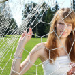 Stock Photo: Beautiful young woman and grid