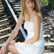 Young woman on the railway — Stock Photo #12325726