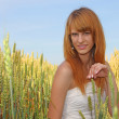 Stock Photo: Beautiful girl in the field