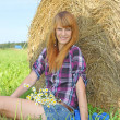 Woman in a field with hay bales — Stock Photo #12325892