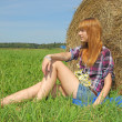 Woman in a field with hay bales — Stock Photo #12325902