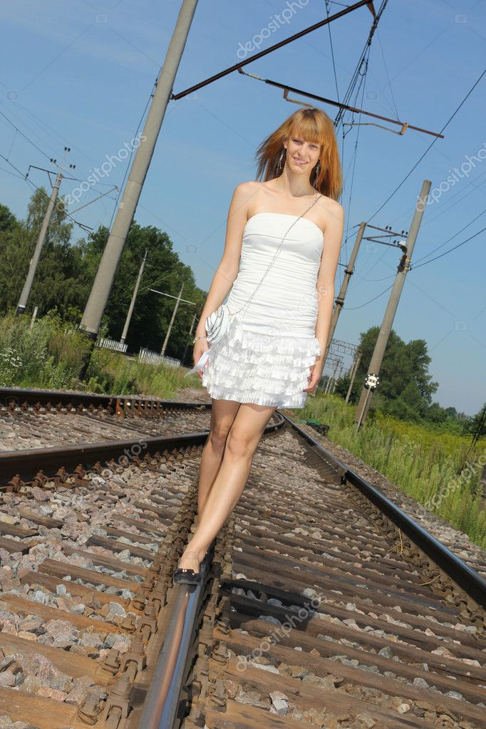 Young woman in white dress on the railway — Stock Photo #12325680