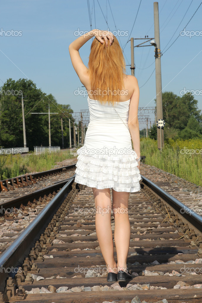 Young woman in white dress on the railway — Stock Photo #12325693