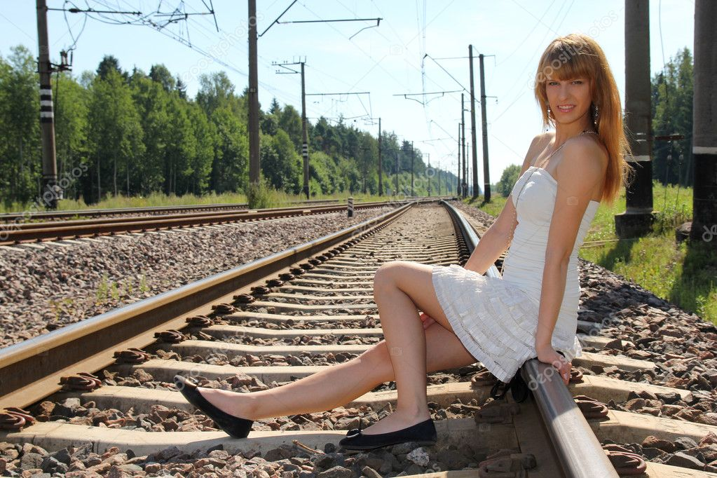 Young woman sitting on the railway  Stock Photo #12325715