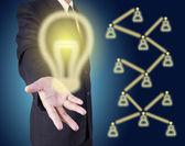 Businessman holding idea — Stock Photo