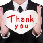 Businessman holding paper heart shape — Stock Photo