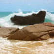 The waves breaking on a stony — Stock Photo