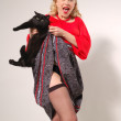 Pin-up surprised girl with black cat — Stock Photo #12113252