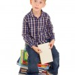 Funny little boy with books — Stock Photo