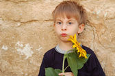 Funny boy with sunflower — Stock Photo