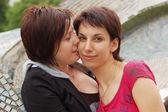 Women kiss — Stock Photo