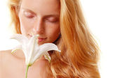Girl smell flower — Stockfoto