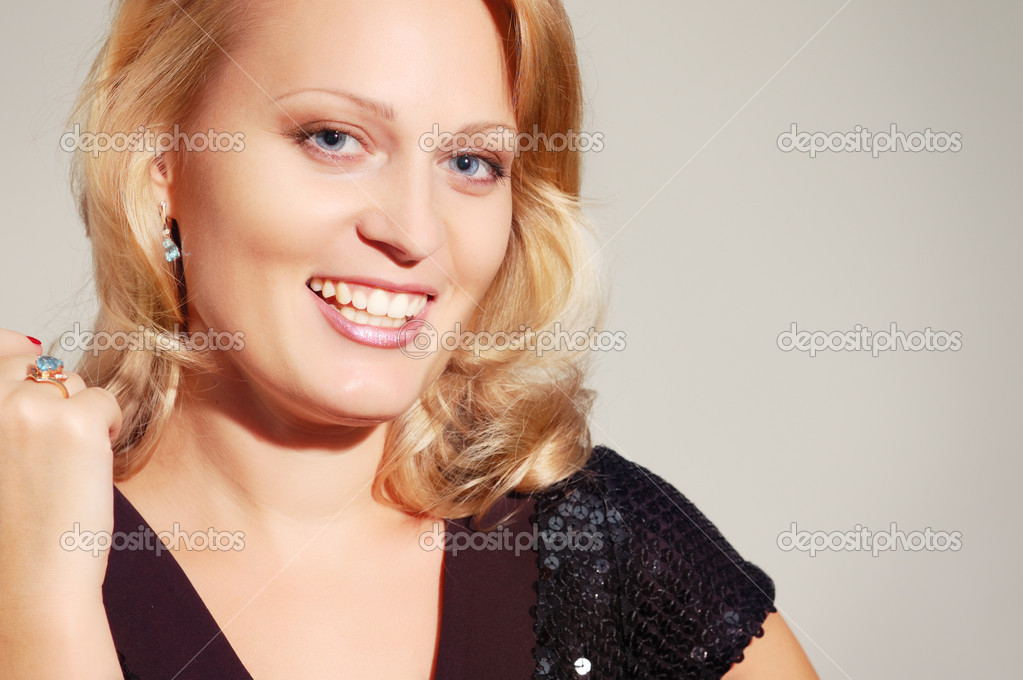 Beautiful smiling blond woman isolated on white background — Stock Photo #12113503