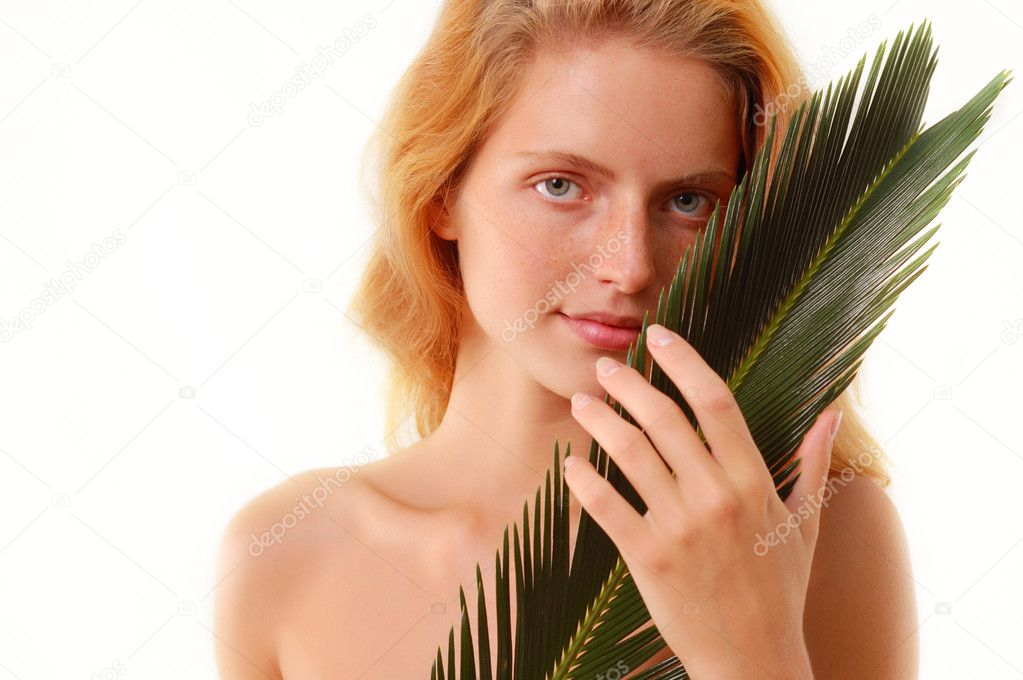 Beautiful girl with plant isolated on white background — Stock Photo #12113574