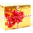 Holiday gift in box with gold foil and red bow — Stock Photo #12128565