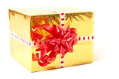 Holiday gift in box with gold foil and red bow — Stock Photo