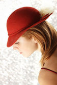 Elegant young woman with red hat — ストック写真