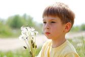Boy with dandelions — Stock Photo