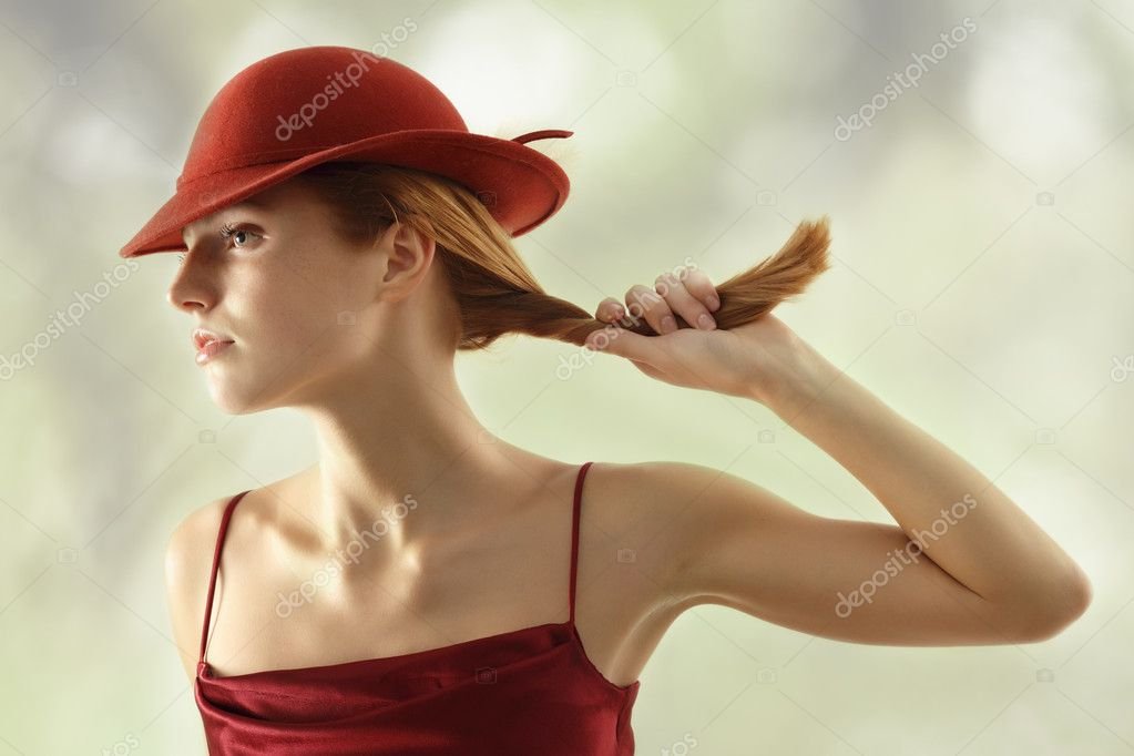 Elegant young woman in dress with bordeaux hat  Stock Photo #12124440
