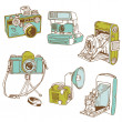 Set of Photo Cameras - hand-drawn doodles in vector — Stock Vector #12007603