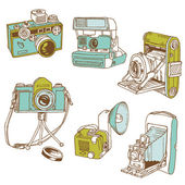 Set of Photo Cameras - hand-drawn doodles in vector — Vecteur