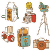 Set of Photo Cameras - hand-drawn doodles in vector — Vettoriale Stock