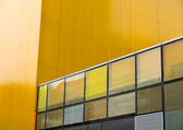 Yellow background building reflection — Stock Photo