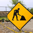 Yellow working men - sign about repair road in fort Galle — Stock Photo