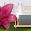 Stock Photo: Soap with natural ingredients , flowers and candle in glass