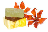 Soap with natural ingredients and flowers — Stock Photo