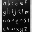 Royalty-Free Stock Photo: Complete english alphabet handwritten with white chalk on a blac