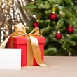 Christmas present with white card — Stock Photo