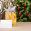 Christmas gift bag with white card — Stock Photo