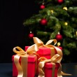 Royalty-Free Stock Photo: Three presents with gold ribbon