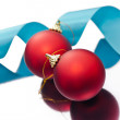 Stock Photo: Christmas baubles and a blue ribbon