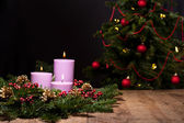 Three candles in an advent flower arrangement — Stock Photo