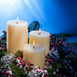Three candles in advent flower arrangement — Stock Photo #11382440