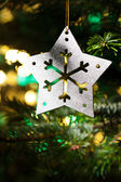 Decorative Silver Star ornament in a Christmas tree — Stock Photo