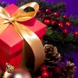Red present box in a Christmas setting close up shoot — Stock Photo