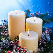 Three candles with snowfall — Stock Photo #11474722