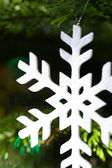 White snow flake in a christmas tree — Stock Photo