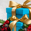 Blue present with gold ribbon — Stock Photo